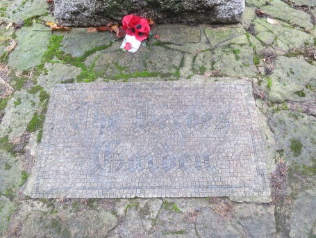 The mosaic reads 'The Heroes Garden'